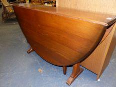 AN ERCOL TYPE ELM DROP LEAF GATELEG SUPPER TABLE ON TRESTLE ENDS. 142 x 127 x H.73cms.