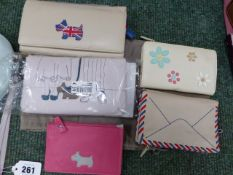 FIVE RADLEY PURSES, MOSTLY WITH DUST COVERS.