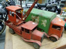 LINES BROS., TRI-ANG, THREE RED PAINTED METAL TOYS, A CRANE, A TIPPER TRUCK AND A GREEN COVERED