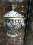 A GERMAN TWO HANDLED POT POURRI BOWL AND COVER, THE LAUREL FRAMED INSECT VIGNETTES ON A BLUE