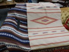 TWO TRIBAL FLAT WEAVE PANELS POSSIBLY FROM CENTRAL AMERICA. LARGEST, 172 x 114cms.
