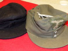 A COMPOSITE MOUNTAIN TROOP FELDMUTZE OR CAP TOGETHER WITH A COPY BLACK WOOLLEN EXAMPLE. (2)