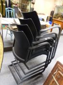 A SET OF EIGHT HERMAN MILLER BLACK CANTILEVER ARMCHAIRS.