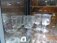 ATTRIBUTED TO JAMES POWELL, A PART SET OF DIMPLED DRINKING GLASSES, SHERRY GLASSES, RED AND WHITE