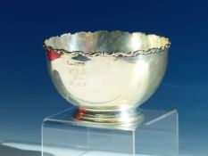 A SILVER PRESENTATION SUGAR BOWL BY JR, SHEFFIELD, 1904, THE WAVY RIM APPLIED ABOVE ROUNDED SIDES.