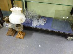 TWO OIL LAMPS, AN ANTIQUE GLASS WASP TRAP, A TALL BATTERY JAR,ETC. (QTY)