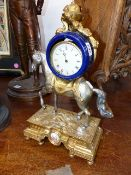 A GILT SILVERED AND BLUE CERAMIC TIMEPIECE SUPPORTED ON THE BACK OF A HORSE. H.43cms.