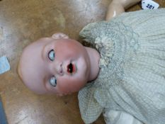 AN ARMAND MARSEILLE 518/9K BISQUE HEADED DOLL WITH SLEEPY EYES AND OPEN MOUTH. H.70cms.