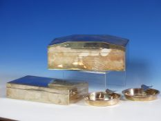 TWO SILVER MOUNTED CIGARETTE BOXES, ONE INSCRIBED 1934 WITH WORN HALLMARKS, THE OTHER B'HAM 1947