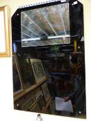 A PAIR OF ART DECO BLACK GLASS BATHROOM MIRRORS. 56 x 84cms.