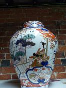 A POTTERY JAR DECORATED IN 18th.C.JAPANESE IMARI TASTE. H.37cms.