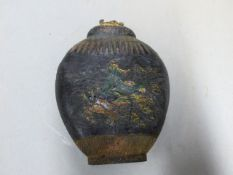 ATTRIBUTED TO WANG JINSHENG. A QING DYNASTY INK CAKE, THE FLATTENED OVOID JAR SHAPE MOULDED IN LOW
