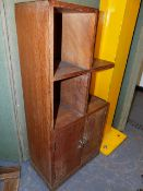 A HEAL'S SMALL OAK BOOKCASE CABINET WITH A TWO DOOR BASE. 40 x 23 x H.87cms.