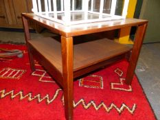 A MID CENTURY TEAK TELEPHONE TABLE, A NEST OF TWO TABLES AND A TEAK COFFEE TABLE. (4)
