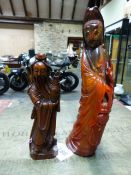 A CHINESE RED STAINED HORN FIGURE OF GUANYIN. H.24.5cms TOGETHER WITH WITH A CARVED WOOD FIGURE OF