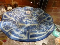 AN ANTIQUE GERMAN DELFT BLUE AND WHITE DISH WITH NINE FLORAL AND CHINOISERIE PANELS ENCLOSING THE