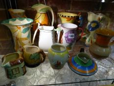 A COLLECTION OF ELEVEN 1930'S JUGS AND A JAR TO INCLUDE WARES BY WADEHEATH, MYOTT, CARLTON AND