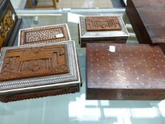 FOUR INDIAN INLAID BOXES, TWO WITH THE TAJ MAHAL CARVED IN RELIEF ON THE LIDS, THE LARGER, 23 x