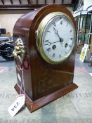 A BRASS INLAID MAHOGANY CASED FRENCH PENDULUM CLOCK STRIKING ON A COILED ROD, THE ROUND DIAL WITH