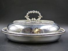 AN OVAL SILVER VEGETABLE DISH AND COVER WITH REMOVABLE BEADED HANDLE BY ELKINGTON & CO, B'HAM 1853