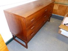 AN E.GOMME G-PLAN TEAK LOW CHEST OF THREE LONG AND THREE SHORT DRAWERS. 131 x 46 x H.72cms.