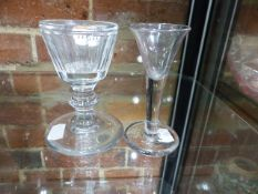 A GEORGIAN FIRING GLASS WITH TRUMPET BOWL ON CLEAR STEM. ANOTHER WITH FACET CUT BUCKET BOWL