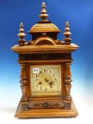 A LATE VICTORIAN WALNUT CASED MANTLE CLOCK WITH PAINTED AND GILT DIAL WITH GONG STRIKE MOVEMENT.
