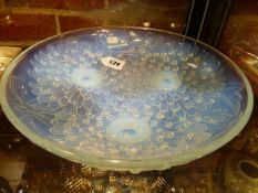 A PIERRE D'AVESN IRRIDESCENT GLASS DISH REVERSE MOULDED WITH THREE DAISY HEADS, SIGNED WITHIN THE