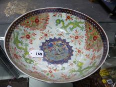 A CHINESE BLUE AND WHITE BOWL, THE ISLAND SCENES TO THE EXTERIOR LATER CLOBBERED WITH EUROPEAN