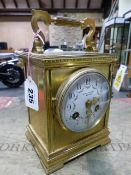 A BRASS CASED CLOCK THE FRENCH MOVEMENT STRIKING ON A COILED ROD BELOW THE PLATFORM ESCAPEMENT,