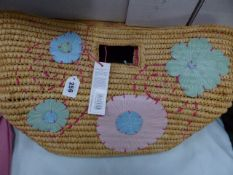 A RADLEY LARGE RATTAN BEACH BAG FROM THE NATURALS RANGE.