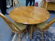 AN ERCOL PALE ELM DROP LEAF DINING TABLE AND A SET OF FOUR HIGH HOOP BACK DINING CHAIRS. (5)