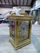 A FRENCH GORGE CASED ALARM CARRIAGE CLOCK, THE REPEAT BUTTON ABOVE CIRCULAR SILVERED DIALS, THE