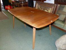 AN ERCOL PALE ELM EXTENDING DINING TABLE WITH TWO LEAVES TOGETHER WITH A SET OF EIGHT ERCOL STICK