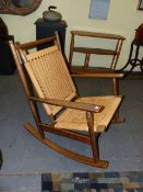 A MID CENTURY ROCKING CHAIR IN THE MANNER OF HANSWEGNER.