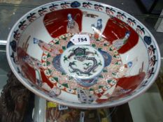 A JAPANESE IMARI BOWL PAINTED ON BOTH THE INTERIOR AND EXTERIOR WITH THE DAOIST IMMORTALS. Dia.