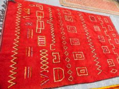 A NORTH AFRICAN TRIBAL CARPET. 315 x 200cms.