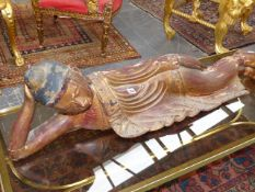 A THAI OR BURMESE GOLD LACQUERED WOOD RECLINING BUDDHA, HIS ROBE EDGES JEWELLED WITH COLOURED GLASS.
