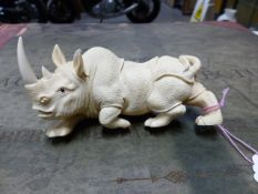 A JAPANESE IVORY CARVING OF A RHINOCEROS, SIGNED. W.13cms.