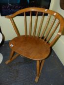 AN ERCOL PALE ELM COTTAGE SMALL ROCKING CHAIR WITH BS1960 STAMP.