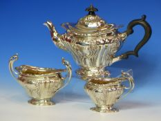 A BATCHELOR'S SILVER THREE PIECE TEASET BY B B, B'HAM 1900 AND 1901, THE FLUTED BODIES WORKED WITH