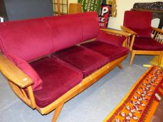 A MID CENTURY THREE PIECE SUITE COMPRISING A THREE SEATER SOFA AND TWO ARMCHAIRS WITH SPINDLE
