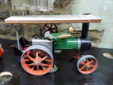 A MAMOD STEAM TRACTION ENGINE TOGETHER WITH A HORNBY No.1 O GAUGE CLOCKWORK LOCOMOTIVE.