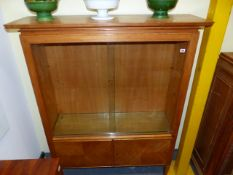 A MID CENTURY OAK GLAZED DISPLAY CABINET WITH ADJUSTABLE GLASS SHELVES. 123 x 37 x H.150cms.