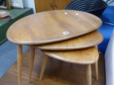 A NEST OF ERCOL PEBBLE TABLES.
