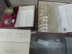 A HAND MADE SILVER PLATED CASED TOAST RACK, A CASED CHRISTENING SET, A CASED CHILD'S KNIFE AND FORK,