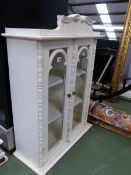 A PAINTED GLAZED WALL CABINET.