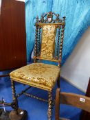 A VICTORIAN GILT DECORATED SALON CHAIR.