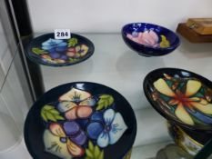 FOUR MOORCROFT PIN DISHES.