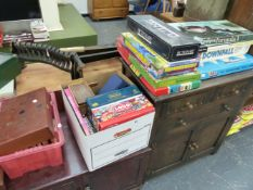 A QTY OF VARIOUS TOYS AND GAMES.